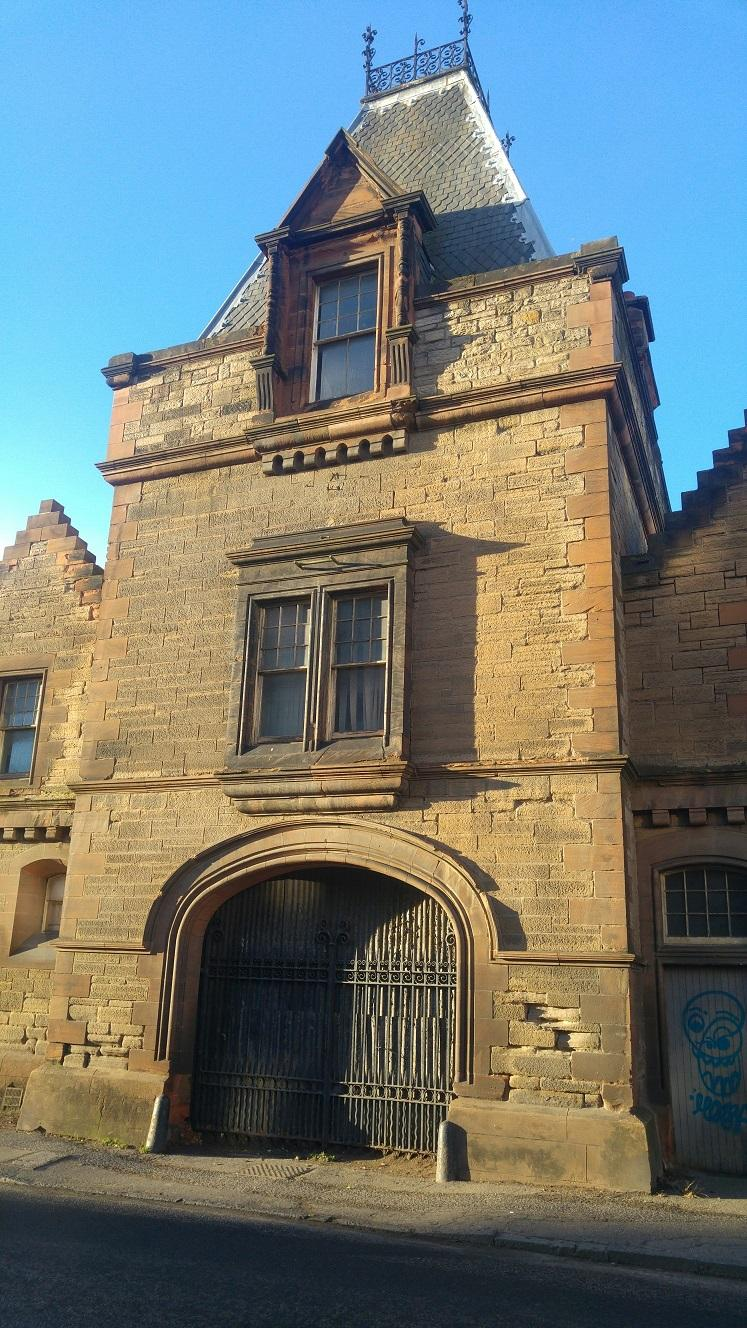 "A photograph of the ""Powderhall Stables"" building in Powderhall, Edinburgh."