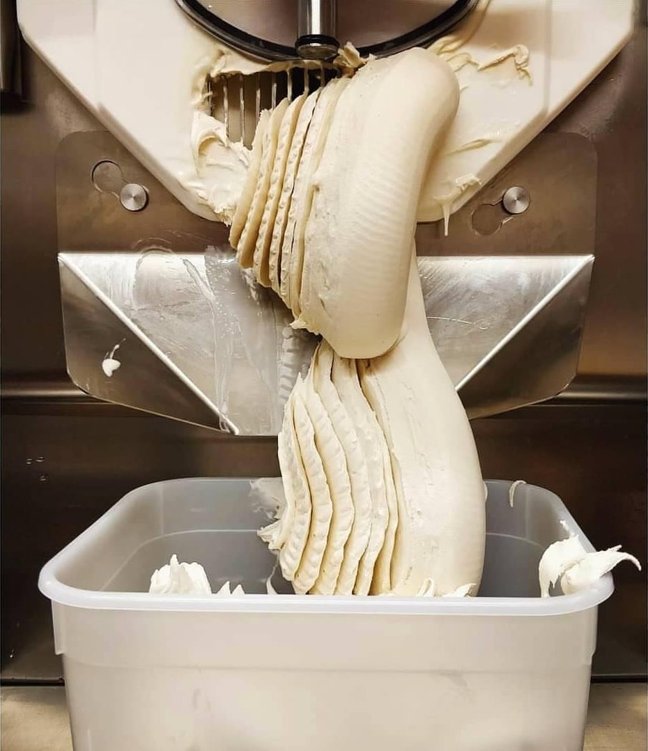 A close up of gelato being made.