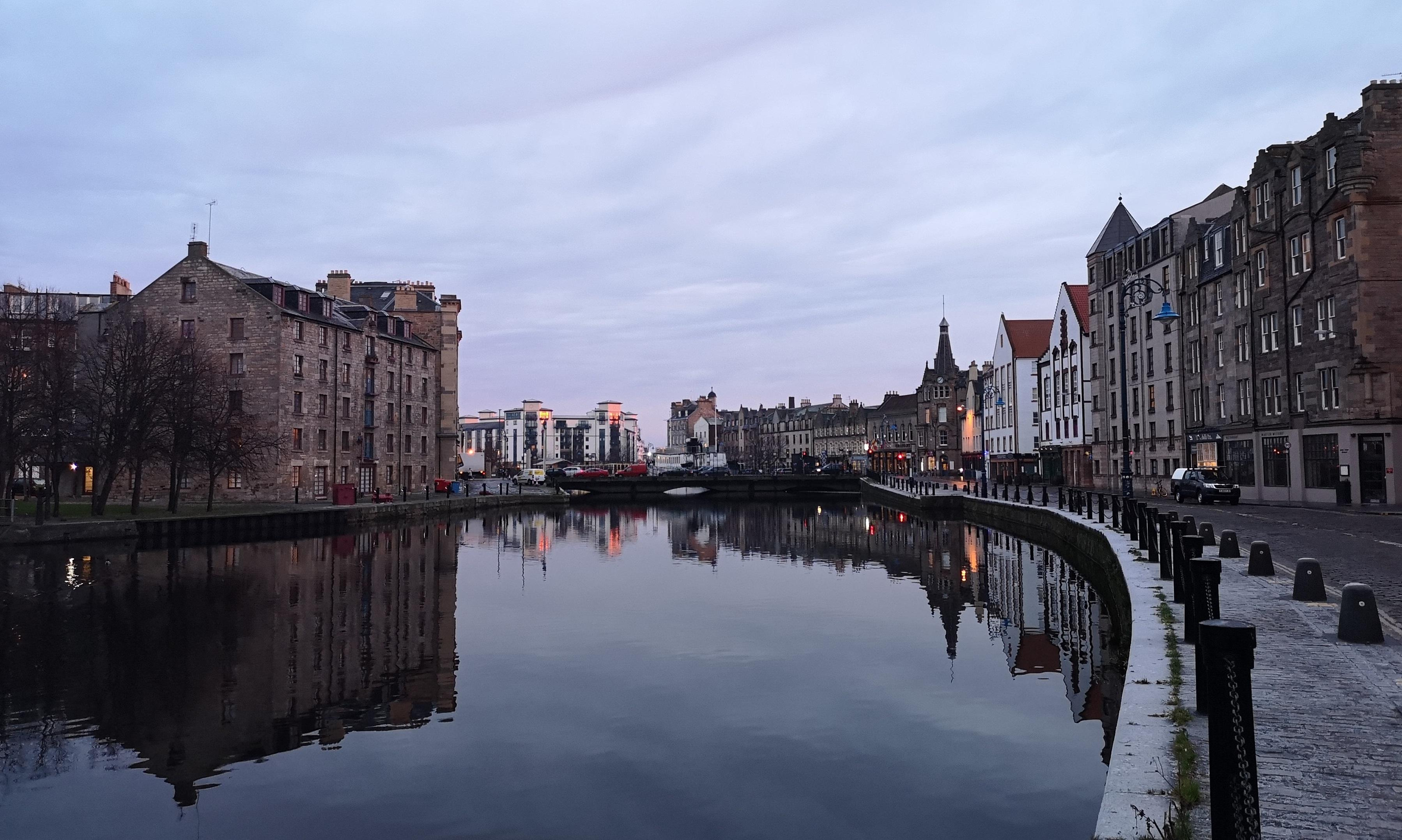 Houses in Leith next to a body of water.